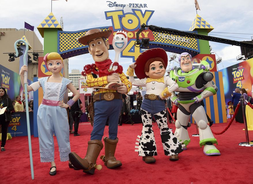 "Characters Bo Peep, from left, Woody, Forky, Jessie and Buzz Lightytear pose at the world premiere of ""Toy Story 4"" on Tuesday, June 11, 2019, at the El Capitan in Los Angeles. (Photo by Chris Pizzello/Invision/AP)"