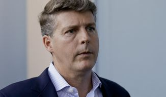 FILE - In this Wednesday, Nov. 15, 2017 file photo, Hal Steinbrenner, principal owner, managing general partner and co-chairman of the New York Yankees, talks with reporters at the annual MLB baseball general managers' meetings in Orlando, Fla. Yankees owner Hal Steinbrenner would consider boosting payroll above the third luxury tax level in an effort to help New York win its first World Series in a decade, Wednesday, June 19, 2019. (AP Photo/John Raoux, File)