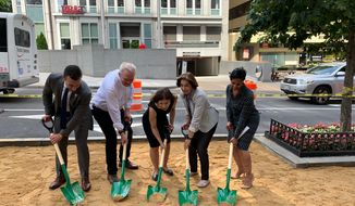 D.C. officials break ground for 10 rain gardens and nine tree boxes at K and 19th streets NW on Thursday. (From left: Jeff Marootian, director of the District Department of Transportation; Tommy Wells, director of the District Department of Energy; Leona Agouridis, executive director of the Golden Triangle Business Improvement District; D.C. Council member Mary Cheh, Ward 3 Democrat; and Donna Cooper, president of Pepco Holdings. (Ximena Bustillo/ The Washington Times)