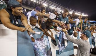 Philadelphia Eagles quarterback Carson Wentz signs autographs for fans following practice at NFL football training camp, Sunday, Aug. 14, 2016, in Philadelphia. (AP Photo/Chris Szagola) **FILE**