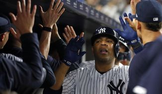 New York Yankees' Edwin Encarnacion celebrates a two-run home run during the seventh inning of the team's baseball game against the Houston Astros on Thursday, June 20, 2019, in New York. (AP Photo/Adam Hunger)