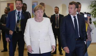 French President Emmanuel Macron, right, speaks with German Chancellor Angela Merkel prior to a meeting during an EU summit in Brussels, Thursday, June 20, 2019. European Union leaders meet for a two-day summit to begin the process of finalizing candidates for the bloc's top jobs. (Kenzo Tribouillard, Pool Photo via AP)