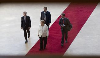 German Chancellor Angela Merkel, center, arrives for an EU summit in Brussels, Thursday, June 20, 2019. European Union leaders meet in Brussels for a two-day summit to begin the process of finalizing candidates for the bloc's top jobs. (AP Photo/Virginia Mayo)