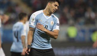 Uruguay's Luis Suarez reacts during a Copa America Group C soccer match against Japan at the Arena Gremio in Porto Alegre, Brazil, Thursday, June 20, 2019. (AP Photo/Edison Vara)