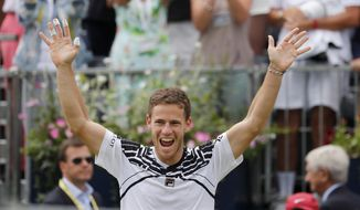 Diego Schwartzman of Argentina celebrates winning the singles match against Marin Cilic of Croatia at the Queens Club tennis tournament in London, Thursday, June 20, 2019. (AP Photo/Frank Augstein)