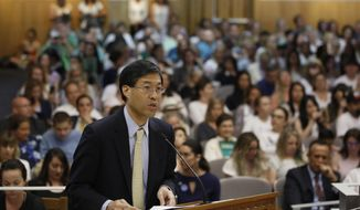 FILE -- In this April 24, 2019 file photo State Sen. Dr. Richard Pan, D-Sacramento, urges lawmakers to approve his proposal to give state public health officials instead of local doctors the power to decide which children can skip their shots before attending school, at the Capitol in Sacramento, Calif. A new version of Pan's bill, which would require public health officials tp scrutinize doctors who grant a high number of exemptions rather than review every exemption, will be will be taken up by the Assembly Health Committee, Thursday, June 20, 2019. (AP Photo/Rich Pedroncelli, File )