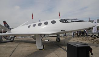 An Israeli Eviation Alice electric aircraft electric aircraft is displayed at Paris Air Show, in Le Bourget, east of Paris, France, Tuesday, June 18, 2019. Israeli startup Eviation displayed an all-electric airplane prototype dubbed Alice at the Paris Air Show, as the aviation industry increasingly looks to electric and hybrid technology because of pressure from regulators and the public to reduce emissions. (AP Photo/Michel Euler)