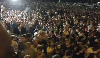 In this image from video, some thousands of protesters gather outside the parliament building in the Georgian capital of Tbilisi Thursday June 20, 2019. Some thousands of protesters have tried to storm the parliament building in Tbilisi and are calling for the government's resignation. (AP Photo)