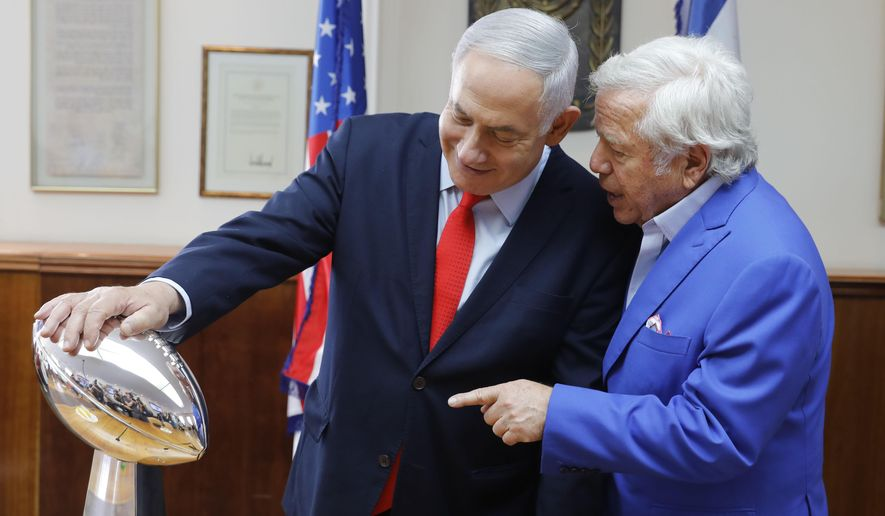 Israel's Prime Minister Benjamin Netanyahu holds the NFL Super Bowl trophy during a meeting with New England Patriots owner Robert Kraft in Jerusalem, Thursday, June 20, 2019. Israel will honor Kraft with the 2019 Genesis Prize for his philanthropy and commitment to combatting anti-Semitism. (AP Photo/Sebastian Scheiner)