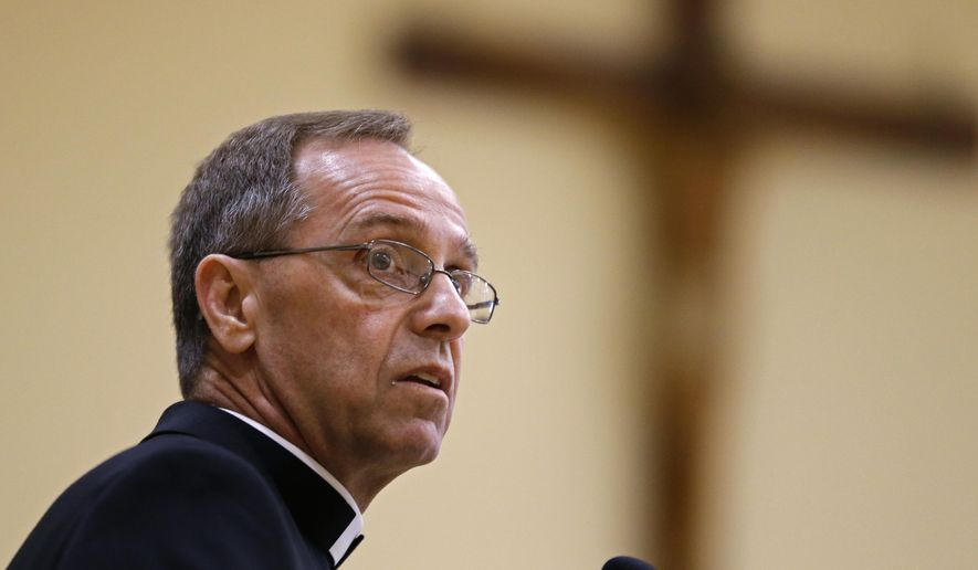 In this June 13, 2017 file photo, Bishop Charles Thompson speaks after he is introduced as the new archbishop of Indianapolis in Indianapolis. The Archdiocese of Indianapolis said it would no longer will recognize a Jesuit high school as Catholic because it refuses to fire a teacher who's in a same-sex marriage. But on Sept. 22, 2019, the Vatican's Congregation for Catholic Education lifted the suspension of Brebeuf Jesuit Preparatory School while an appeal filed by the Society of Jesus, which oversees the school, is heard by the Vatican court. (AP Photo/Michael Conroy, File) **FILE**