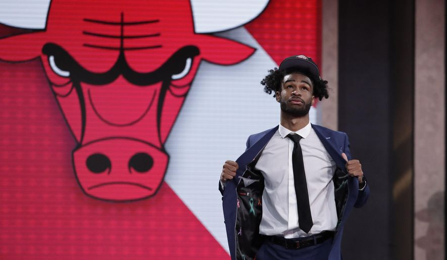North Carolina's Coby White walks onstage after the Chicago Bulls selected him as the seventh overall in the NBA basketball draft Thursday, June 20, 2019, in New York. (AP Photo/Julio Cortez)