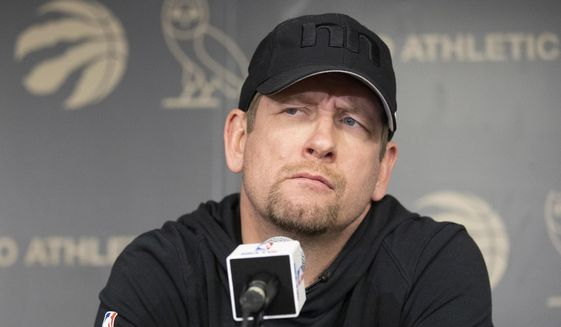 Toronto Raptors head coach Nick Nurse takes questions from the media in Toronto on Sunday, June 16, 2019. The Raptors defeated the Golden State Warriors in Game 6 of basketball's NBA Finals. (Chris Young/The Canadian Press via AP)