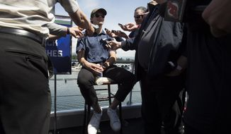 Top prospect Jack Hughes, of Orlando, Fla., speaks to the media during an NHL hockey draft top prospects media availability in Vancouver, British Columbia, Thursday, June 20, 2019. (Jonathan Hayward/The Canadian Press via AP)