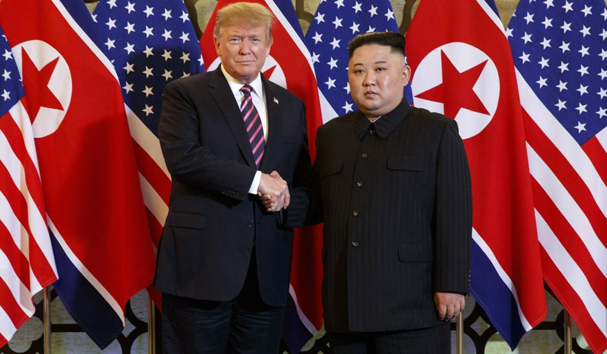 FILE - In this Feb. 27, 2019, file photo, U.S. President Donald Trump, left, poses with North Korean leader Kim Jong Un for a photo in Hanoi, Vietnam. Nuclear negotiations between Washington and Pyongyang have stalled since February, when the second meeting between Kim and Trump collapsed because of disagreements over the amount of sanctions relief in exchange for disarmament steps. (AP Photo/Evan Vucci, File)