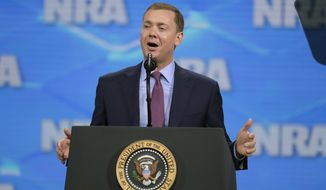 In this April 26, 2019 file photo, Nation Rifle Association Institute for Legislative Action Executive Director Christopher W. Cox speaks at the NRA-ILA Leadership Forum in Lucas Oil Stadium in Indianapolis. Mr. Cox resigned his post as the NRA's chief lobbyist on June 26, 2019. (AP Photo/Michael Conroy, File) **FILE**