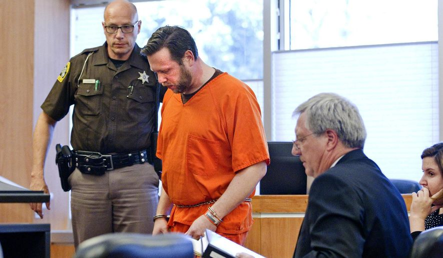 Christopher Cox appears in 86th District Court for a preliminary hearing on Tuesday, June 11, 2019, in Traverse City, Mich. Cox, a Long Lake Church pastor, is accused of luring two men separately to a Traverse City office, offering them meth and sexually assaulting them once they became drunk or inebriated. (Jan-Michael Stump/Traverse City Record-Eagle via AP)