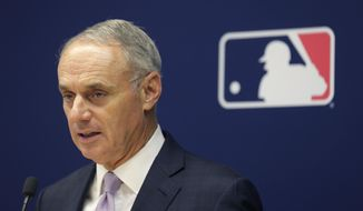 Major League Baseball commissioner Rob Manfred speaks to reporters after a meeting of baseball team owners in New York, Thursday, June 20, 2019. The Tampa Bay Rays have received permission from Major League Baseball's executive council to explore a plan that could see the team split its home games between the Tampa Bay area and Montreal, reports said Thursday.(AP Photo/Seth Wenig)