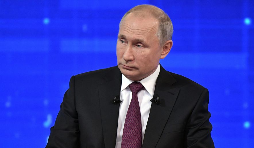 Russian President Vladimir Putin listens during his annual call-in show in Moscow, Russia, Thursday, June 20, 2019. Putin hosts call-in shows every year, which typically provide a platform for ordinary Russians to appeal to the president on issues ranging from foreign policy to housing and utilities. (Alexei Nikolsky, Sputnik, Kremlin Pool Photo via AP)