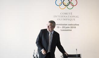International Olympic Committee, IOC, President Thomas Bach from Germany, reacts prior to the opening of the International Olympic Committee, IOC, executive board meeting in Lausanne, Switzerland, Wednesday, June 19, 2019. (Jean-Christophe Bott/Keystone via AP)