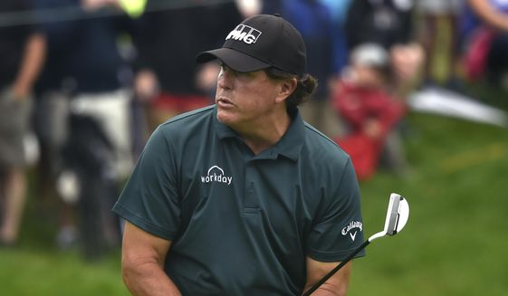 Phil Mickelson reacts to missing a birdie putt on the 9th green during first round play at the Travelers Championship golf tournament at TPC River Highlands, Thursday, June 20, 2019 in Cromwell, Conn.(Brad Horrigan/Hartford Courant via AP) ** FILE **