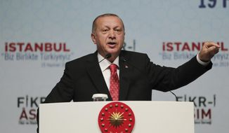 """Turkey's President Recep Tayyip Erdogan, gestures as he talks regarding Saudi journalist Jamal Khashoggi's Oct. 2, 2018 killing, in Istanbul, Wednesday, June 19, 2019. An independent U.N. human rights expert investigating the killing of Saudi journalist Jamal Khashoggi recommended an investigation into the possible role of Saudi Crown Prince Mohammed bin Salman, citing """"credible evidence"""", and suggested sanctions on his personal assets. (Presidential Press Service via AP, Pool"""
