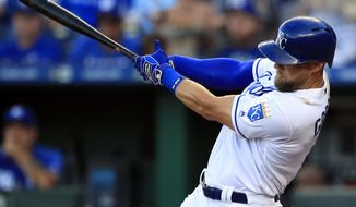 Kansas City Royals' Alex Gordon hits a two-run double off Minnesota Twins starting pitcher Jake Odorizzi during the first inning of a baseball game at Kauffman Stadium in Kansas City, Mo., Thursday, June 20, 2019. (AP Photo/Orlin Wagner)