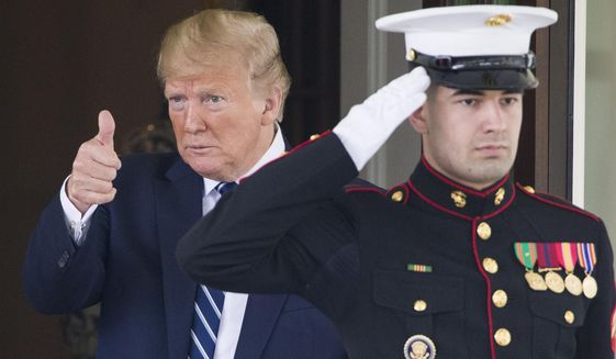 President Donald Trump gives thumbs up to the media as Canadian Prime Minister Justin Trudeau departs the White House, Thursday, June 20, 2019, in Washington. (AP Photo/Alex Brandon)
