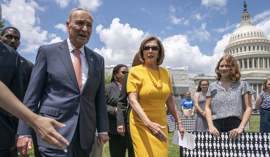 Senate Minority Leader Chuck Schumer, D-N.Y., left, and Speaker of the House Nancy Pelosi, D-Calif., walk at the Capitol in Washington, Thursday, June 20, 2019. (AP Photo/J. Scott Applewhite) **FILE**