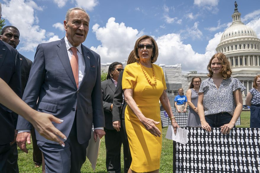 Senate Minority Leader Chuck Schumer, D-N.Y., left, and Speaker of the House Nancy Pelosi, D-Calif., walk at the Capitol in Washington, Thursday, June 20, 2019. (AP Photo/J. Scott Applewhite) **FILE**