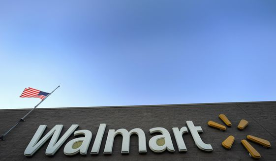 "FILE- This Nov. 9, 2018, file photo shows a Walmart Supercenter in Houston. Walmart agreed Thursday, June 20, 2019, to pay $282 million to settle civil and criminal allegations of overseas corruption, including payment through a Brazilian subsidiary of more than $500,000 to an intermediary known as a ""sorceress"" for her uncanny ability to make permit problems disappear. (AP Photo/David J. Phillip, File)"