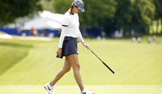 Michelle Wie walks across the 18th green after missing a putt during the first round of the KPMG Women's PGA Championship golf tournament, Thursday, June 20, 2019, in Chaska, Minn. (AP Photo/Charlie Neibergall)
