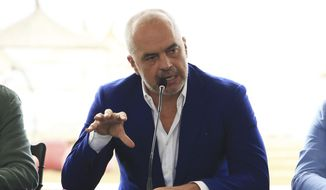 FILE - In this file photo from Aug. 27, 2018, Albanian Prime Minister Edi Rama talks during a meeting in the western port city of Durres. Rama said in an interview with The Associated Press on Friday, June 21, 2019, in Tirana, Albania, that the opposition's main goal is to disrupt the country's efforts to launch full membership negotiations with the European Union. (AP Photo/Hektor Pustina, File)