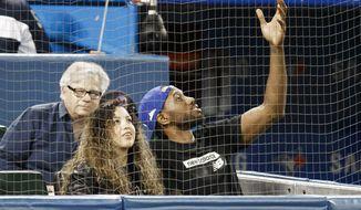 Toronto Raptors' Kawhi Leonard and his girlfriend, Kishele Shipley, watch the Toronto Blue Jays play the Los Angeles Angels during a baseball game Thursday, June 20, 2019, in Toronto. (Mark Blinch/The Canadian Press via AP) **FILE**