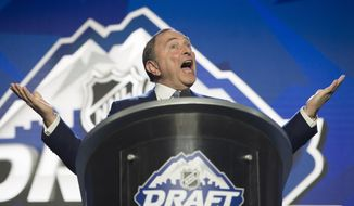 NHL Commissioner Gary Bettman opens the hockey league's draft in Vancouver, British Columbia, Friday, June, 21, 2019. (Jonathan Hayward/The Canadian Press via AP)