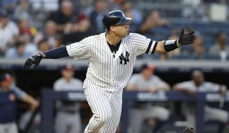New York Yankees' Gary Sanchez drops his bat after hitting a two-run home run during the third inning of a baseball game against the Houston Astros, Friday, June 21, 2019, in New York. (AP Photo/Kathy Willens)