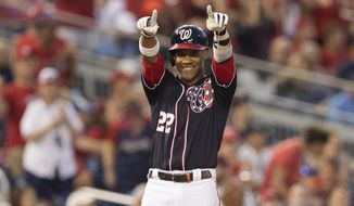 Washington Nationals Juan Soto (22) gestures after hitting a triple during the fifth inning of a baseball game against the Atlanta Braves in Washington, Friday, June 21, 2019. (AP Photo/Manuel Balce Ceneta)