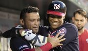 Washington Nationals, Juan Soto, front right, celebrates with teammate Gerardo Parra after scoring during the fifth inning of a baseball game against the Atlanta Braves in Washington, Friday, June 21, 2019. (AP Photo/Manuel Balce Ceneta)