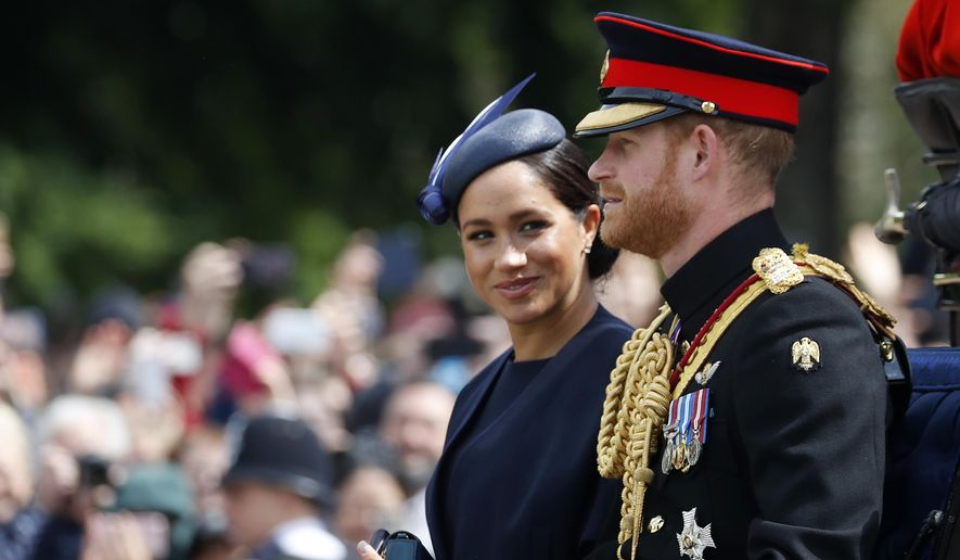 In this Saturday, June 8, 2019, file photo, Britain's Meghan, the Duchess of Sussex and Prince Harry ride in a carriage to attend the annual Trooping the Colour Ceremony in London. Kensington Palace says on Thursday, June 20 the Duke and Duchess of Sussex will be starting their own foundation to support their charitable endeavors, formally spinning off from the entity Prince Harry and Prince William established together a decade ago. (AP Photo/Frank Augstein, file)