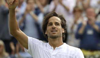 Feliciano Lopez of Spain reacts at match point after winning against Milos Raonic of Canada during their quarterfinal singles match at the Queens Club tennis tournament in London, Friday, June 21, 2019. (AP Photo/Kirsty Wigglesworth)