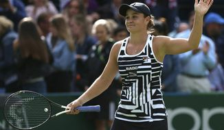 Australia's Ashleigh Barty celebrates after winning her match against Venus Williams of the U.S during day seven of the Nature Valley Classic at Edgbaston Priory Club, Birmingham, England, Friday, June 21, 2019. (Nigel French/PA via AP)