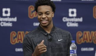 Cleveland Cavaliers' Darius Garland answers questions during a news conference, Friday, June 21, 2019, in Independence, Ohio. The Cavaliers selected Garland with the No. 5 overall pick Thursday night despite the point guard playing in five games at Vanderbilt before injuring his left knee. Garland was always on Cleveland's radar, but they became convinced that he was the right choice during a private workout last week in Los Angeles. (AP Photo/Tony Dejak)