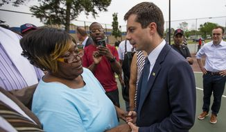 In this Wednesday, June 19, 2019, file photo, South Bend Mayor and Democratic presidential candidate Pete Buttigieg shares a moment with Shirley Newbill, mother of Eric Logan, during a gun violence memorial at the Martin Luther King Jr. Recreation Center in South Bend, Ind. (Michael Caterina/South Bend Tribune via AP)