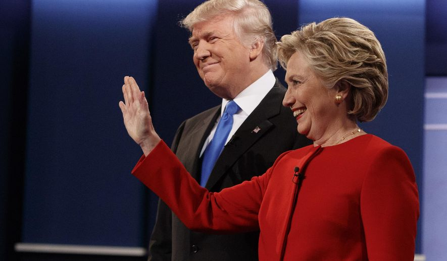 In this Sept. 26, 2016 file photo, then Republican presidential candidate Donald Trump, left, stands with then Democratic presidential candidate Hillary Clinton before the first presidential debate at Hofstra University in Hempstead, N.Y. Gearing up to take on Democratic front-runner Joe Biden, President Donald Trump sees echoes of his original political foe, Hillary Clinton.  (AP Photo/ Evan Vucci)
