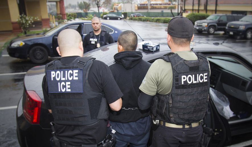 In this Feb. 7, 2017, file photo released by U.S. Immigration and Customs Enforcement, foreign nationals are arrested during a targeted enforcement operation conducted by U.S. Immigration and Customs Enforcement (ICE) aimed at immigration fugitives, re-entrants and at-large criminal aliens in Los Angeles. (Charles Reed/U.S. Immigration and Customs Enforcement via AP, File)
