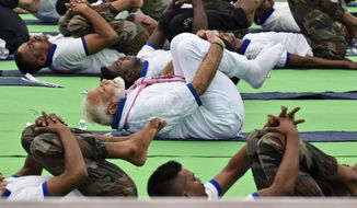 Indian Prime Minister Narendra Modi performs yoga during an event to mark International Yoga Day in Ranchi, the capital of the eastern Indian state of Jharkhand, Friday, June 21, 2019. Yoga enthusiasts across the world Friday took part in mass yoga events to mark International Yoga Day. (AP Photo/Rajesh Kumar)