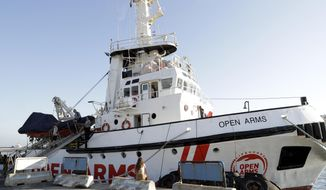 The Open Arms ship is moored at the Naples harbor, Italy, Thursday, June 20,2 019. The Spanish NGO migrant ship Open Arms is in Naples with activists speaking to media and the public to mark World Refugee Day. (AP Photo/Andrew Medichini)