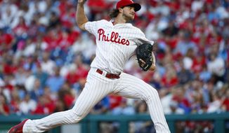 Philadelphia Phillies' Aaron Nola pitches during the third inning of a baseball game against the Miami Marlins, Friday, June 21, 2019, in Philadelphia. (AP Photo/Matt Slocum)
