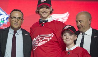 Detroit Red Wings pick Moritz Seider smiles while wearing a Red Wings jersey during the first round of the NHL hockey draft Friday, June 21, 2019, in Vancouver, British Columbia. (Jonathan Hayward/The Canadian Press via AP)