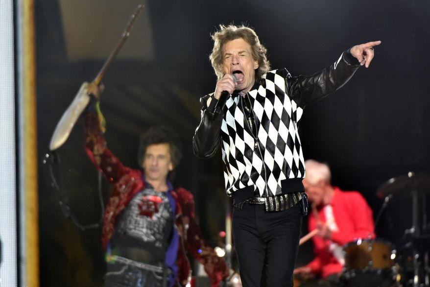 """Ron Wood, left, and Mick Jagger, of the Rolling Stones perform during the """"No Filter"""" tour at Soldier Field on Friday, June 21, 2019, in Chicago. (Photo by Rob Grabowski/Invision/AP)"""