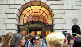 """FILE - This Sept 10, 2010, file photo shows people lining up to enter the Bergdorf Goodman store, in New York. E. Jean Carroll, a New York-based advice columnist claims Donald Trump sexually assaulted her in a dressing room at a Manhattan department store in the mid-1990s. The first-person account was published Friday, June 21, in New York magazine. Trump denied the allegations and said """"I've never met this person in my life."""" (AP Photo/Stephen Chernin, File)"""